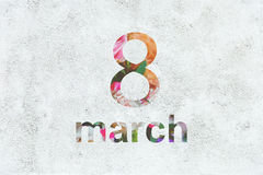 March 8 on the white background with texture of stucco. March 8 on the white background Royalty Free Stock Photo