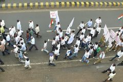 March against corruption in India. A march by a group of people holding banners at Jabalpur, a small town in India , to support Anna Hazare for his nation wide stock images