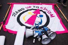 March Against Racism National Demonstration - London - United Kingdom. London, UK. 17th March 2018. EDITORIAL - Large banner and four megaphones at the March royalty free stock image