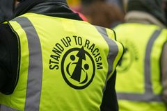 March Against Racism National Demonstration - London - United Kingdom. London, UK. 17th March 2018. EDITORIAL - Marshals wearing reflective vest at the March stock photos