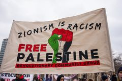 March Against Racism National Demonstration - London - United Kingdom. London, UK. 17th March 2018. EDITORIAL - One of the larger posters and banners seen at royalty free stock photo