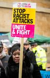 March Against Racism National Demonstration - London - United Kingdom. London, UK. 17th March 2018. EDITORIAL - Protester holding a placard at the March Against royalty free stock photography