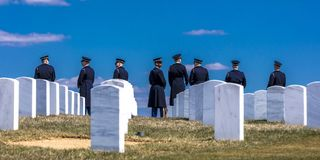 MARCH 26, 2018 - ARLINGTON, WASHINGTON D.C. - Honor Guard anticipates Burial at Arlington National. Saluting, unknown royalty free stock photography