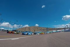 NASCAR: March 11 Ticket Guardian 500k. March 11, 2018 - Avondale, Arizona, USA: Martin Truex, Jr 78 and Kyle Larson 42 lead the field to the green flag to start royalty free stock photo