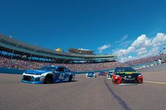 NASCAR: March 11 Ticket Guardian 500k. March 11, 2018 - Avondale, Arizona, USA: Martin Truex, Jr 78 and Kyle Larson 42 lead the field to the green flag to start royalty free stock images
