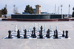 March 10, 2017, Azneft square, Baku, Azerbaijan. A large chessboard in the seaside Park, Kids playing chess. Azneft square, Baku, Azerbaijan. A large chessboard Stock Photo