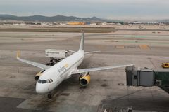 03 March 2018, Barcelona, Spain. Spanish Vueling Airbus at the gate of the Airport el Prat in Barcelona stock photo