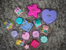 Collection of Polly Pocket`s, miniature dollhouses, that were very popular in the 90`s and now are coveted. March 2019 - Belgium Collection of Polly Pocket`s stock photography
