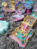 Collection of Polly Pocket`s, miniature dollhouses, that were very popular in the 90`s and now are coveted. March 2019 - Belgium Collection of Polly Pocket`s royalty free stock photos