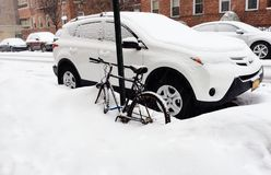 March bicycle under snow in new york Royalty Free Stock Image