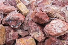 March Birthstone Mineral Red Jasper. Jasper, an aggregate of microgranular quartz and/or chalcedony and other mineral phases is an opaque impure variety of stock image