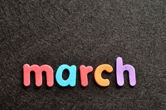 March on a black background Stock Photo