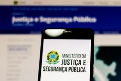 March 10, 2019, Brazil. Logo of the Ministry of Justice and Public Security of Brazil on the screen of the mobile device. It is an stock photo