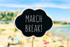 March break in a black signboard on the beach Stock Photo