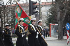 March 3, 2016: Bulgarian Army officers with Battle Flag marching on the Bulgaria Liberation Day parade in Varna, Bulgaria Royalty Free Stock Photography
