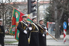 March 3, 2016: Bulgarian Army officers with Battle Flag marching on the Bulgaria Liberation Day's parade in Varna, Bulgaria Stock Image
