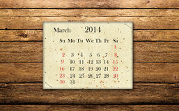 March 2014. Calendar of March 2014 on the wooden background Stock Photo