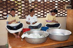 March 25, 2014. Cambodia: unidentified girls sat spinning silk b Royalty Free Stock Photos
