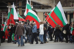 March 3, 2016: Citizens carrying Bulgaria National Flag marching for the National Liberation Day in Varna, Bulgaria Stock Photos