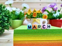 March. Colorful cube letters on sticky note block. royalty free stock photo