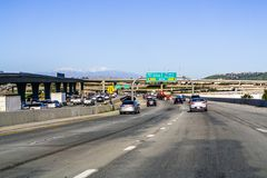 March 16, 2019 Corona / CA / USA - Approaching I15 and driving towards San Diego on a day with heavy traffic; San Bernardino. Mountains visible in the stock photography