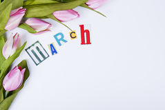 March. Creative March composition, tulips, separate calendar page with copy space Stock Images