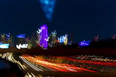MARCH 5, 2018, DALLAS SKYLINE TEXAS, and Tom Landry Freeway, with streaked lights on Interstate 30. Night, Speed stock image
