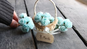 March 8 - decorative lettering card. Rustic still life, roses. March 8 label and beautiful basket of roses on vintage table stock footage