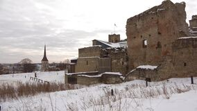 March gloomy day at the ruins of the medieval castle of the Livonian knight order. Rakvere, Estonia. March gloomy day at the ruins of the medieval castle of the stock video