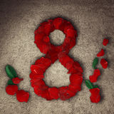 8 march. Greeting card with red rose petals arranged in shape of a eight. Eight march, International Women's Day Royalty Free Stock Photography