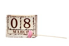 8 March Happy Women`s Day with wooden block calendar and pink lips on a stick, isolated on white royalty free stock image