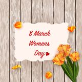 March 8. International Women`s Day. Congratulations on Women`s Day. Fresh spring tulips on a white rustic wooden background Stock Illustration