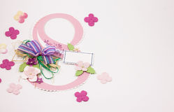 March 8 - International Women's Day. Decorative figure 8 of paper, decorated with paper flowers and bow. Can be used as greeting card for the International Women Vector Illustration