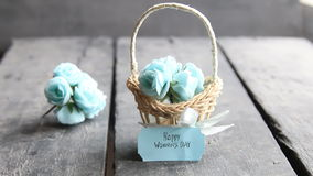 March 8. International Women`s Day greeting card with flowers. Beautiful bouquet of blue flowers in basket. March 8. International Women`s Day greeting card stock video footage