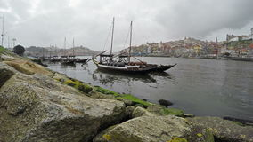 March 06, 2017 - 4K. Traditional Portuguese boats on Douro river, City of Porto, Portugal.  stock footage
