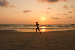 09 March 2017. Koh Chang, Trat Thailand. Women running on the be. Ach at sunset time. silhouette of the girl exercise Stock Image
