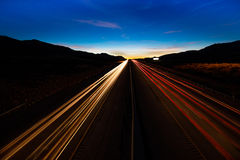 MARCH 12, 2017, LAS VEGAS, NV - streaked lights at sunset over Interstate 15, south of Las Vegas, Nevada at sunset Royalty Free Stock Photography