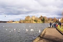 Families enjoying spells of sunny weather beside Linlithgow Loch. March 5 2016: Linlithgow, Scotland, UK - Families enjoying spells of sunny weather beside Royalty Free Stock Photo