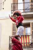 March 22, 2015. Little girl on the top of human castle. Castellers Royalty Free Stock Photography