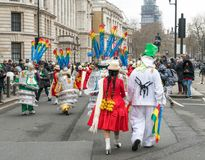 St Patrick`s Parade in London. 18 March 2018 - London, England. Colourful dancers from Bolivia walking after St Patrick`s parade in London Royalty Free Stock Photography