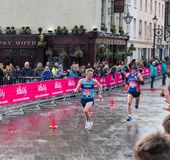 The Vitality Big Half Marathon in London. 4 March 2018 - London, England. 100 yards to the finish line. Runners fighting for the better time in Big half marathon Royalty Free Stock Photography