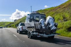 March 20, 2019 Los Angeles / CA / USA - Truck carrying large boat on the interstate stock photo