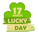 17 March lucky day with shamrock sign, green drawn banner. 17 March lucky day - text in green drawn banner with four leaved shamrock symbol, holiday seasonal Stock Image
