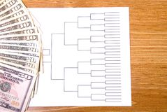 March Madness Bracket and Fanned Money. A basketball tournament bracket and fanned money royalty free stock images