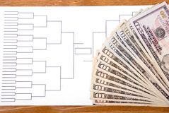 March Madness Bracket and Fanned Money on Right Royalty Free Stock Images