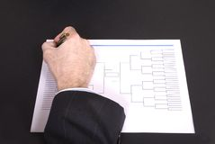 March Madness Businessman Hand Filling In Bracket From Above Royalty Free Stock Image