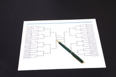 March Madness Pen and Blank Tournament Bracket. A pen on top of an blank March Madness tournament bracket Stock Image