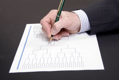 March Madness Pen and Blank Tournament Bracket. A pen on top of an blank March Madness tournament bracket Royalty Free Stock Image