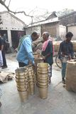 March 3, 2017, Matiari, West Bengal, India. Buyers Checking The Brass Buckets That Were Fabricated At A Nearby Shop. Royalty Free Stock Images