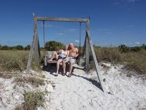 March 10 2015, Miami Florida: Tourists post in a swing that is placed on the beach. Swings like this attract tourists to stock images